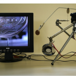 """""""Real Instável"""", 2007-2008, microcâmera de vídeo, monitor, agulha, moeda, alumínio e mecanismos de aço, dimensões variáveis"""