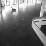 Background noise - video instalação composta de 5 monitores de cftv, 5 dvd players e 4 câmeras de segurança. colaboração de Daniel Steegmann e Dionís Escorsa, 2005-06. foto de Renata Lucas