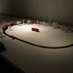 Partitura, 2010:2011, electric train, rails, rods, bottles, cups and wood, variable dimensions
