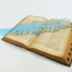 """""""Quadratriz"""" (série Desmesuras), 2015, 1 dicionário de 40 x 28 cm e recortes de papel azul encerado"""
