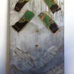 """""""Stela # 7 (amarildo)"""", 2013, cimento, embalagem de cimento e recortes de jornal, 180x70x5 cm"""