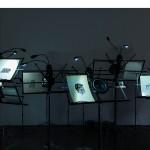 """""""Interpretação"""", canais de áudio, estantes de partitura, cartões, dimensões variáveis, 30ª Bienal de São Paulo, SP, 2012"""