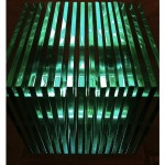 """""""Eros e Tanatos"""", 2012, madeira, vidros, esferas de aço inox e lâmpadas fluorescentes, 45 x 45 x 52 cm"""