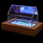 """""""Encontros nº 1"""", 2013, caixa de madeira, acrílico, monitor de LED e vídeo, edição: 1/5, 34x48x33 cm"""