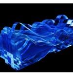 """""""Água viva"""", 2012, pintura automotiva sobre marcenaria, acrílico cristal, espelhos, monitor de led, projeção e circuito elétrico, 66 x 42 x 18 cm"""