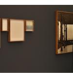 """""""Estudos para Manutenção da Paisagem"""", 2013, impressão em papel algodão, estante em ferro, intervenção sobre vidro, base de concreto, 700x300 cm (aprox.)"""
