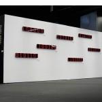 """""""Acervo"""", 2007, sete imagens digitais decodificadas em displays luminosos LED, sete etiquetas de identificação, 13x90 cm (cada  display), 5x10 cm (cada etiqueta)"""